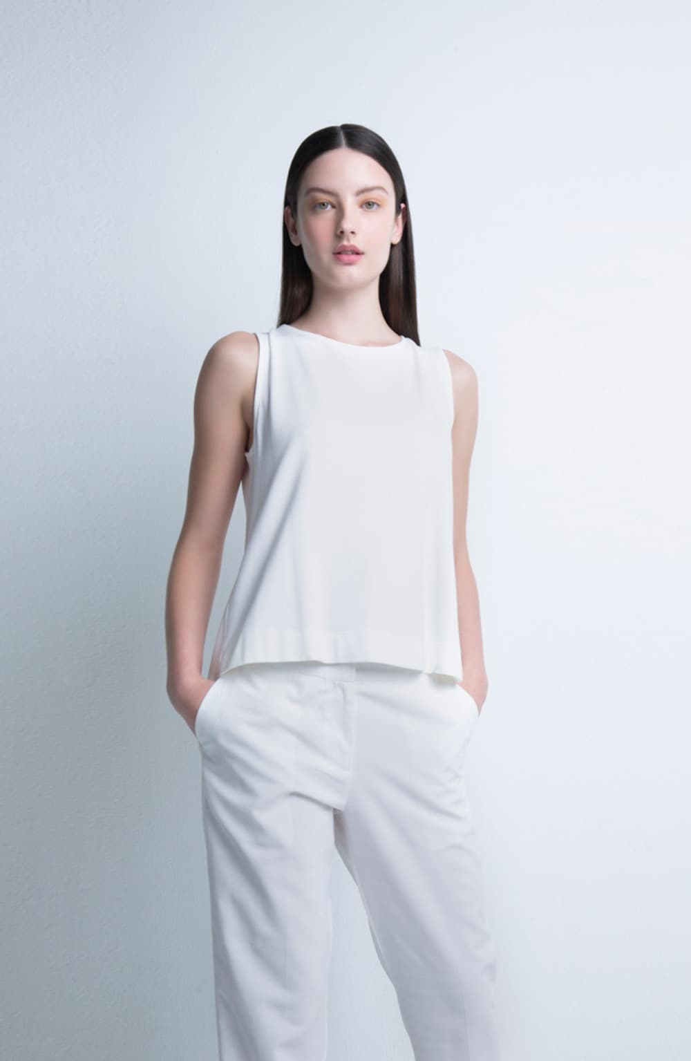 top off white de malha volume costas